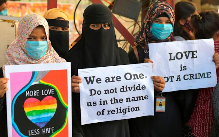 The 'Love Jihad' laws have sparked protests - AFP