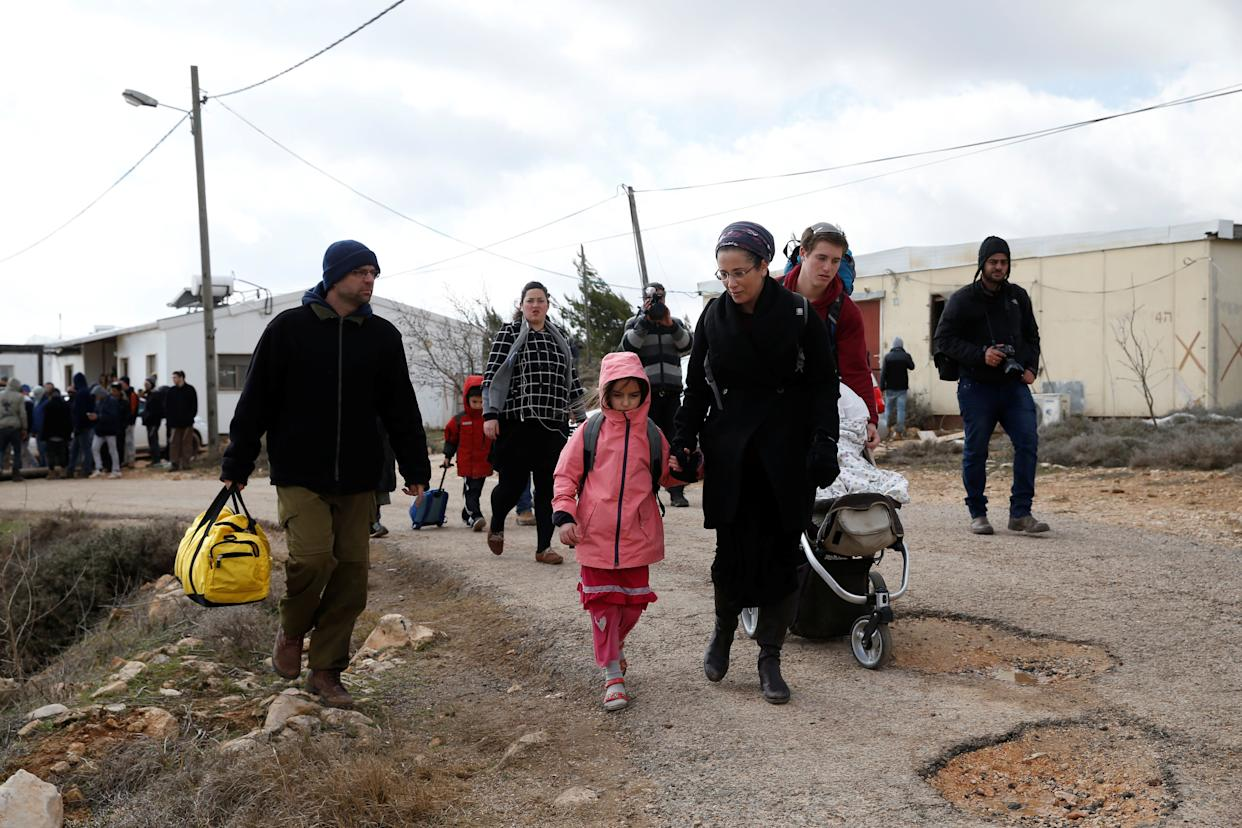 An Israeli settler family leave during an eviction by Israeli police.