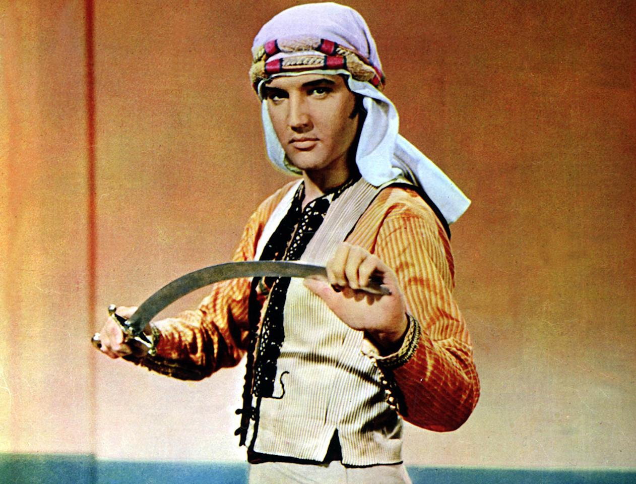 "Elvis Presley in ""Harum Scarum""  There aren't that many peaks in Elvis's early '60s burst of movie-making, but this 1965 stinker is generally regarded as one of his silliest. How bad was it? Even Colonel Parker, Presley's any-movie-for-a-buck manager, thought it was terrible. Elvis plays a movie star who is kidnapped on a promotional visit to the Middle East by Arabians who think his on-screen derring-do is real and want him to carry out an assassination. The level of tension in all the derring-do that proceeds is, well, not high, especially since the star seems to believe there is no moment of danger that can't pause for a song. As the website 3B noted, ""The film's abysmal soundtrack was recorded before filming even began, and when I calculated it out, there's a song approximately every 7.2 minutes -- all of them as forgettable as the film itself."""