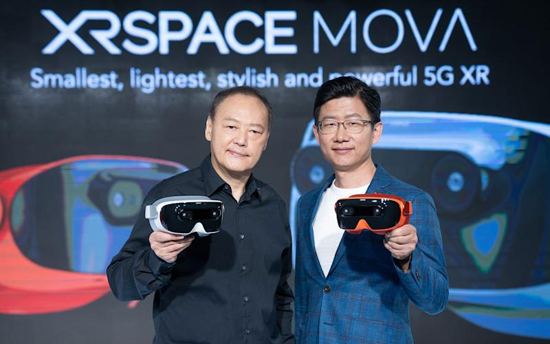 XRSpace founder Peter Chou and platform president Sting Tao holding the Mova headset.