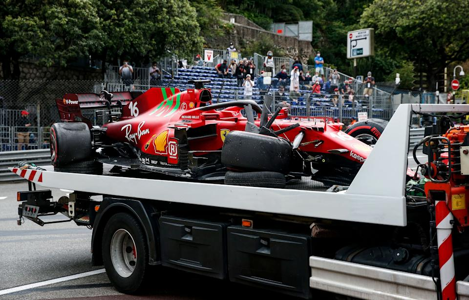 A truck carry the damaged car of Ferrari's Monegasque driver Charles Leclerc in the parc ferme after the qualifying session at the Monaco street circuit in Monaco, on May 22, 2021, ahead of the Monaco Formula 1 Grand Prix. (Photo by Sebastien Nogier / POOL / AFP) (Photo by SEBASTIEN NOGIER/POOL/AFP via Getty Images)