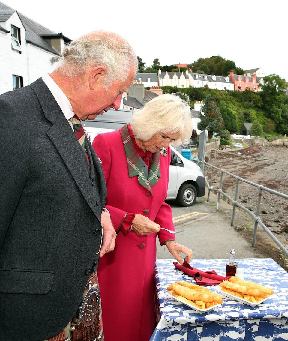 The couple sampled some local fish and chips (William Urquhart/PA) (PA Wire)