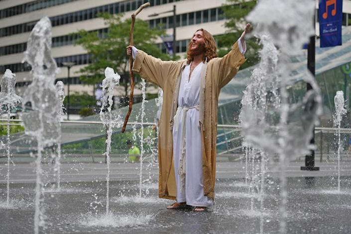 <p>A man dressed a Jesus stands in a water fountain at City Hall on day four of the Democratic National Convention (DNC) on July 28, 2016 in Philadelphia, Pa. (Photo: Jeff J Mitchell/Getty Images)</p><p><br></p>