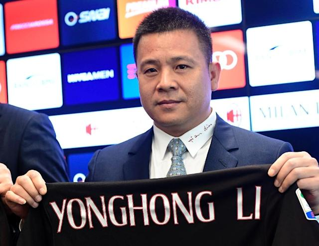AC Milan President Li Yonghong poses with a jersey of the club during a press conference on April 14, 2017 in Milan (AFP Photo/Miguel MEDINA)