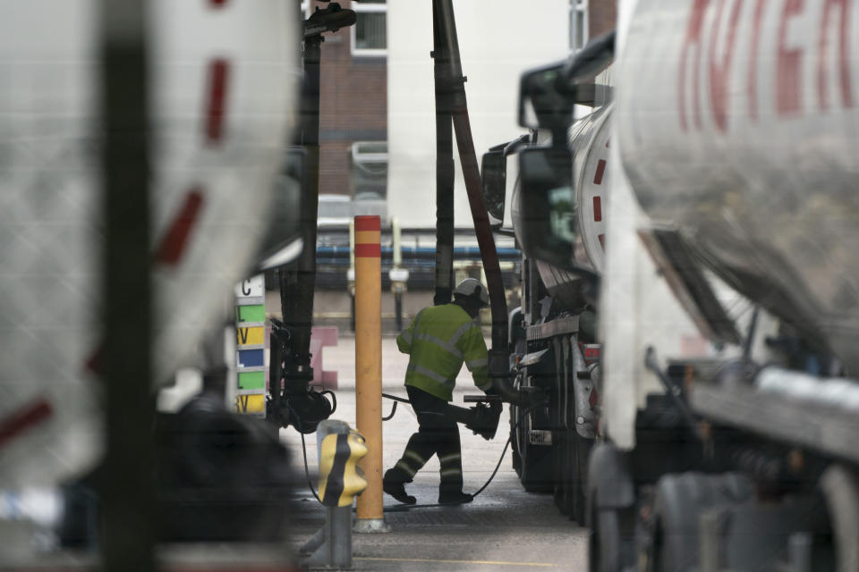 Fuel tankers are filled at the Valero Manchester Terminal, in Manchester, England, Tuesday, Sept. 28, 2021. Thousands of British gas stations have run dry, as motorists scrambled to fill up amid a supply disruption due to a shortage of truck drivers. Long lines of vehicles formed at many gas stations over the weekend, and tempers frayed as some drivers waited for hours. (AP Photo/Jon Super)