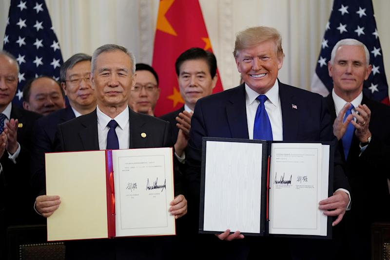 "U.S. President Donald Trump stands Chinese Vice Premier Liu He after signing ""phase one"" of the U.S.-China trade agreement in the East Room of the White House in Washington, U.S., January 15, 2020. REUTERS/Kevin Lamarque?"