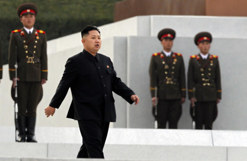North Korean leader Kim Jong Un arrives for the unveiling ceremony for statues of late leaders Kim Jong Il and Kim Il Sung on Mansudae in Pyongyang, North Korea, Friday, April 13, 2012. (AP Photo/Ng Han Guan)