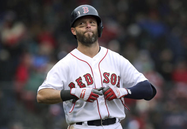 """FILE - In this Tuesday, April 9, 2019 file photo, Boston Red Sox's Dustin Pedroia takes off his gloves after lining out to right field to end the sixth inning of the home opener baseball game against the Toronto Blue Jays in Boston. Red Sox second baseman Dustin Pedroia had what the team called a """"significant setback"""" while rehabbing his left knee, the latest blow to the four-time All-Star's attempt to return to the field. Boston spokesman Kevin Gregg confirmed the development Tuesday, Jan. 21, 2020. (AP Photo/Charles Krupa, File)"""