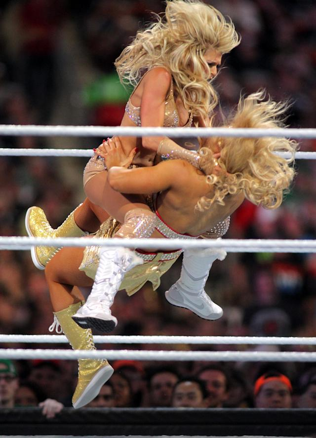 Kelly Kelly and Beth Phoenix compete at WrestleMania XXVIII in Sun Life Stadium on April 1, 2012 in Miami, Florida. (Marc Serota/AP Images)