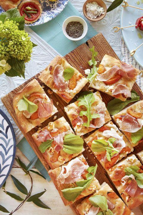 """<p>This easy appetizer only requires six ingredients.</p><p><strong><a href=""""https://www.countryliving.com/food-drinks/recipes/a38083/apricot-prosciutto-focaccia-recipe/"""" rel=""""nofollow noopener"""" target=""""_blank"""" data-ylk=""""slk:Get the recipe"""" class=""""link rapid-noclick-resp"""">Get the recipe</a>.</strong></p>"""