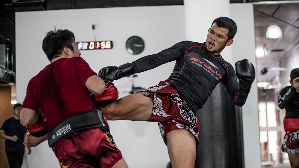 Multiple-time Muay Thai World Champion Nong-O Gaiyanghadao training at Evolve MMA (Far East Square) in Singapore.