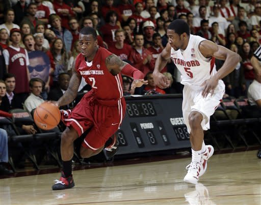 Washington State 's Mike Ladd (2) dribbles past Stanford 's Chasson Randle (5) during the first half of an NCAA college basketball game in Stanford, Calif., Wednesday, Jan. 9, 2013. (AP Photo/Marcio Jose Sanchez)