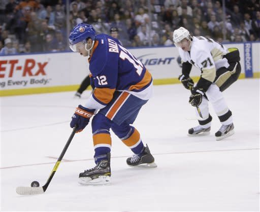 New York Islanders' Josh Bailey, left, takes the puck in to score short-handed while Pittsburgh Penguins' Evgeni Malkin looks on during the second period of the NHL hockey game on Thursday, March 29, 2012, in Uniondale, N.Y. (AP Photo/Seth Wenig)