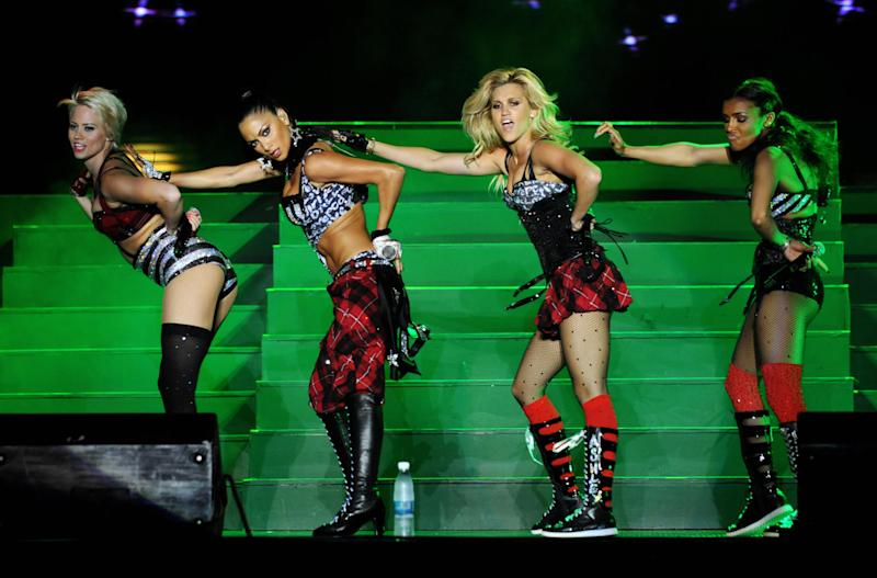 The Pussycat Dolls Kimberly Wyatt, Nicole Scherzingeron, Ashley Roberts and Melody Thornton perform in Manila on June 11, 2009. (Jay Directo/AFP via Getty Images)