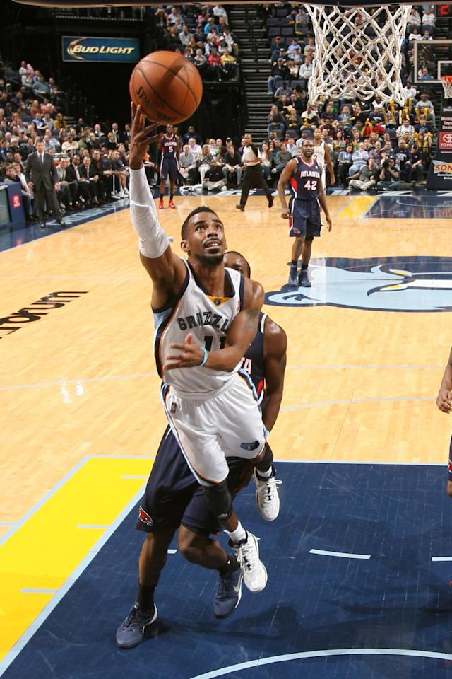 MEMPHIS, TN - JANUARY 12: Mike Conley #11 of the Memphis Grizzlies drives to the basket against the Atlanta Hawks on January 12, 2014 at FedExForum in Memphis, Tennessee. (Photo by Joe Murphy/NBAE via Getty Images)