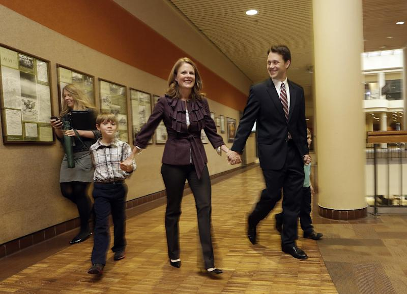 Georgia State Sen. Jason Carter (D-Decatur) arrives for a news conference with his wife Kate, and son Henry, where he announced he has filed paperwork to run for governor, Thursday, Nov. 7, 2013, in Atlanta. Carter is the grandson of former President Jimmy Carter. (AP Photo/John Bazemore)