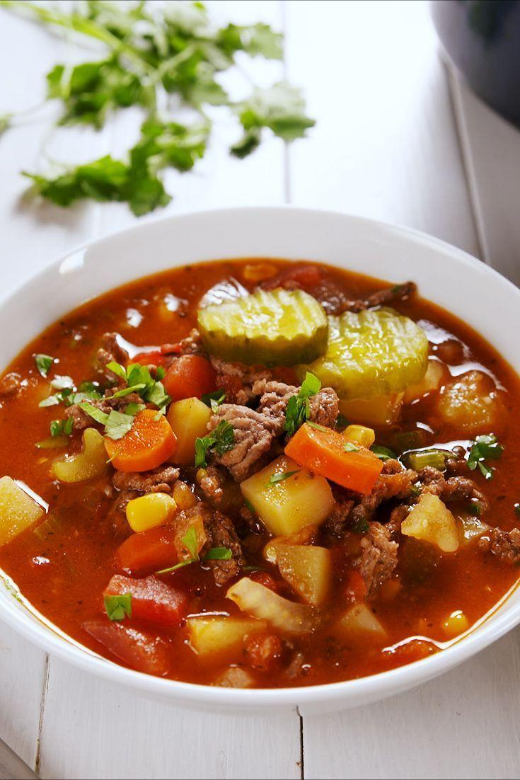 """<p>If you're trying to get some picky eaters on board with a winter soup dinner, try this hamburger-inspired soup, complete with pickles as garnish. </p><p><strong><em>Get the recipe at <a href=""""https://www.delish.com/cooking/recipe-ideas/a25607694/hamburger-soup-recipe/"""" rel=""""nofollow noopener"""" target=""""_blank"""" data-ylk=""""slk:Delish"""" class=""""link rapid-noclick-resp"""">Delish</a>. </em></strong></p>"""