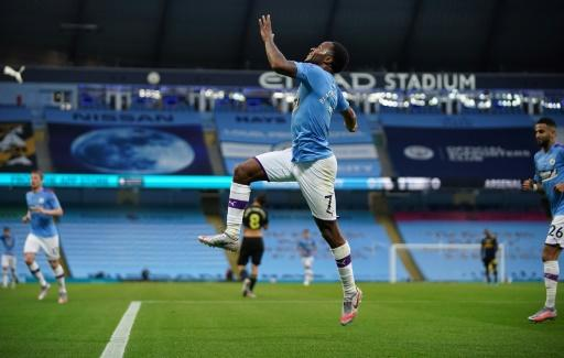 Raheem Sterling celebrates his first goal of 2020 in front of empty stands at the Etihad