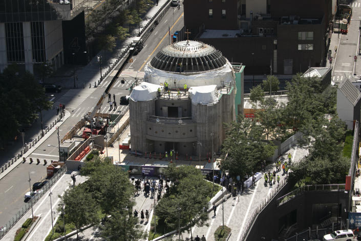 Construction resumes on the St. Nicholas Greek Orthodox Church, Monday, Aug. 3, 2020 at the World Trade Center in New York. The original church was destroyed in the attacks of Sept. 11, 2001. The shrine is expected to open in 2021. (AP Photo/Mark Lennihan)
