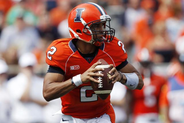 Illinois quarterback Nathan Scheelhaase (2) looks for an opening during the first half of an NCAA college football game against Cincinnati on Saturday, Sept. 7, 2013, in Champaign, Ill. (AP Photo/Andrew A. Nelles)