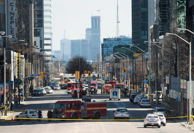 <p>Emergency services close Yonge Street in Toronto after a van mounted a sidewalk crashing into a crowd of pedestrians on Monday, April 23, 2018. (Photo: Nathan Denette/The Canadian Press via AP) </p>