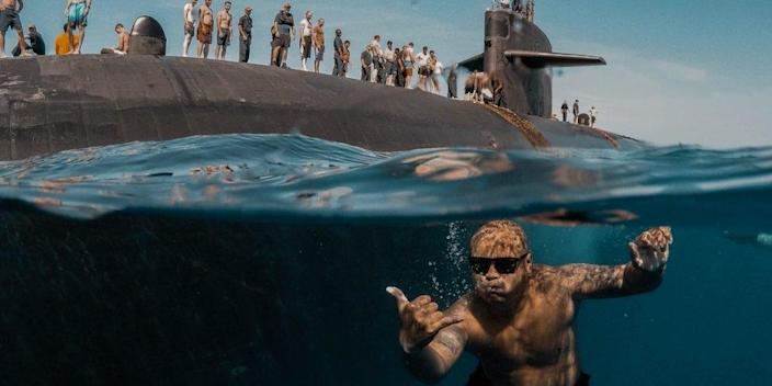 Sailors assigned to Los Angeles-class fast-attack submarine USS Olympia (SSN 717) participate in a swim call at sea