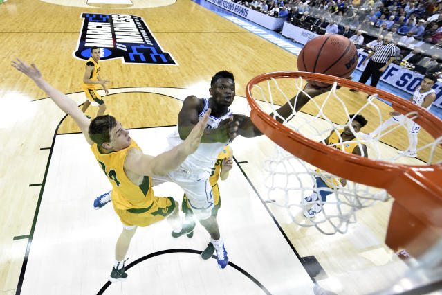 <p>Zion Williamson #1 of the Duke Blue Devils puts up a shot over Rocky Kreuser #34 of the North Dakota State Bison in the first round of the 2019 NCAA Men's Basketball Tournament held at Colonial Life Arena on March 22, 2019 in Columbia, South Carolina. (Photo by Grant Halverson/NCAA Photos via Getty Images) </p>