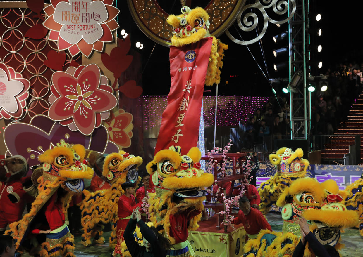 Performers with dragon puppets dance in a night parade to celebrate Chinese New Year in Hong Kong, Saturday, Jan. 28, 2017. The Lunar New Year this year marks the Year of the Rooster in the Chinese calendar. (AP Photo/Vincent Yu)