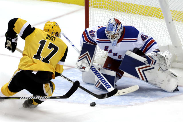 Pittsburgh Penguins' Bryan Rust (17) cannot get a shot off in front of New York Rangers goaltender Alexandar Georgiev (40) during the first period of an NHL hockey game in Pittsburgh, Sunday, Feb. 17, 2019. (AP Photo/Gene J. Puskar)