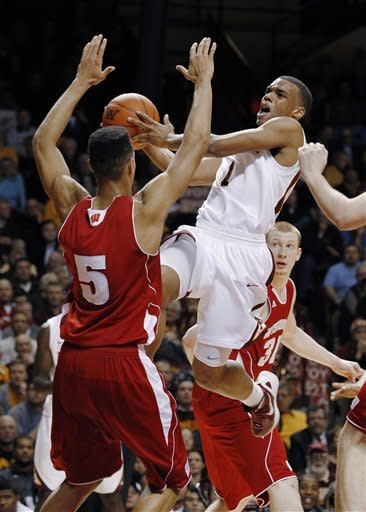 Minnesota's Andre Hollins (1) is fouled as he drives toward the basket against Wisconsin's Ryan Evans (5) during the second half of an NCAA college basketball game Thursday, Feb. 9, 2012, in Minneapolis. Wisconsin defeated Minnesota 68-61 in overtime. (AP Photo/Genevieve Ross)