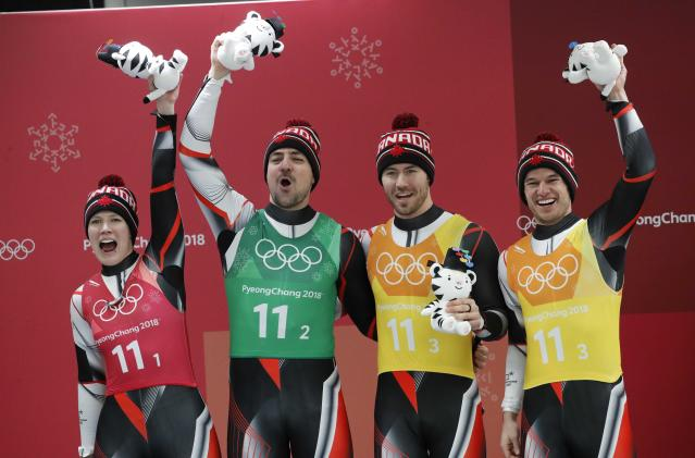 Luge - Pyeongchang 2018 Winter Olympic Games - Team Relay - Pyeongchang, South Korea - February 15, 2018 - Silver medalists Alex Gough, Sam Edney, Tristan Walker and Justin Snith of Canada celebrate during the victory ceremony. REUTERS/Arnd Wiegmann