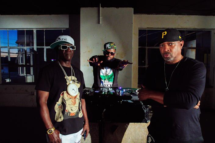 """Flavor Flav, left, DJ Lord and Chuck D on the set of the """"State of the Union (STFU)"""" music video."""