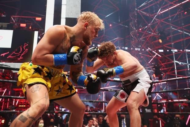 Jake Paul, left, fought Ben Askren in a novelty cruiserweight bout during Triller Fight Club in Atlanta on Saturday. Paul won via first-round TKO. (Al Bello/Getty Images for Triller - image credit)
