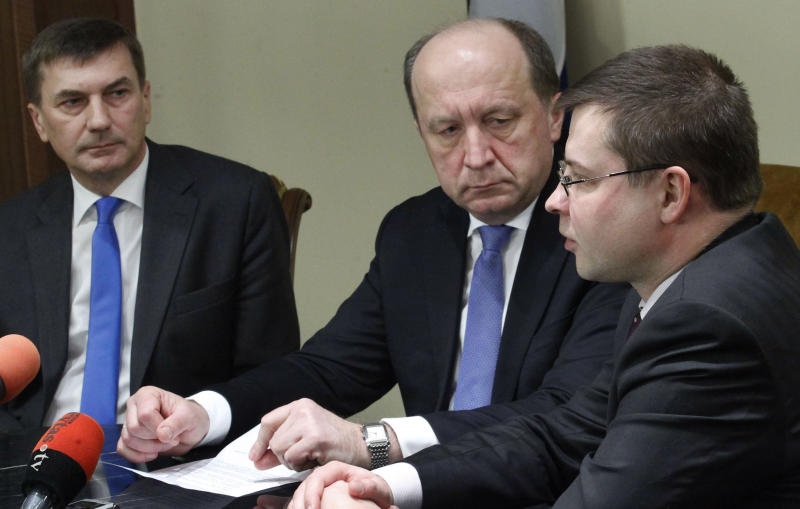Latvia's Prime Minister Valdis Dombrovskis, right, Estonia's Prime Minister Andrus Ansip, left, and Lithuania's Prime Minister Andrius Kubilius is seen during a meeting with the press in Vazgaikiemio village, Prienai district, some 125 kilometers (77,5 miles) from Vilnius, Lithuania, Thursday, March 8, 2012. The meeting may outline how each Baltic country will contribute to a future nuclear power plant, planned to be construct at Ignalina, Lithuania. (AP Photo/Mindaugas Kulbis)