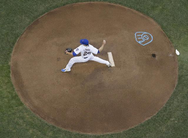 Milwaukee Brewers starting pitcher Kyle Lohse throws during the first inning of a baseball game against the Philadelphia Phillies Wednesday, July 9, 2014, in Milwaukee. (AP Photo/Morry Gash)