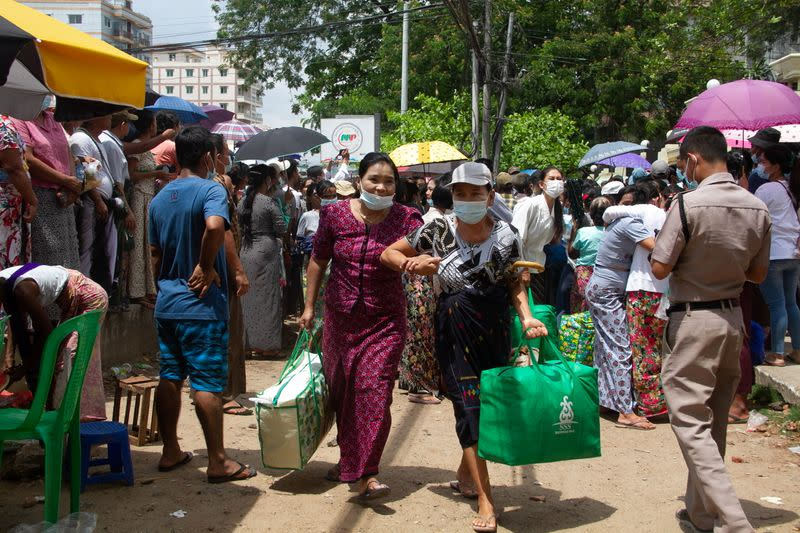 Relatives and friends wait outside the Insein Prison in Yangon