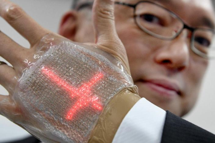 Palmreading could take on a whole new meaning thanks to a new invention from Japan: an ultra-thin display and monitor that can be stuck directly to the body (AFP Photo/TORU YAMANAKA)