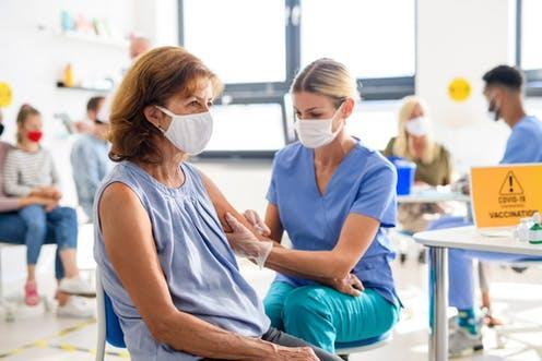 """<span class=""""attribution""""><a class=""""link rapid-noclick-resp"""" href=""""https://www.shutterstock.com/image-photo/woman-face-mask-getting-vaccinated-coronavirus-1814780726"""" rel=""""nofollow noopener"""" target=""""_blank"""" data-ylk=""""slk:Halfpoint/Shutterstock"""">Halfpoint/Shutterstock</a></span>"""