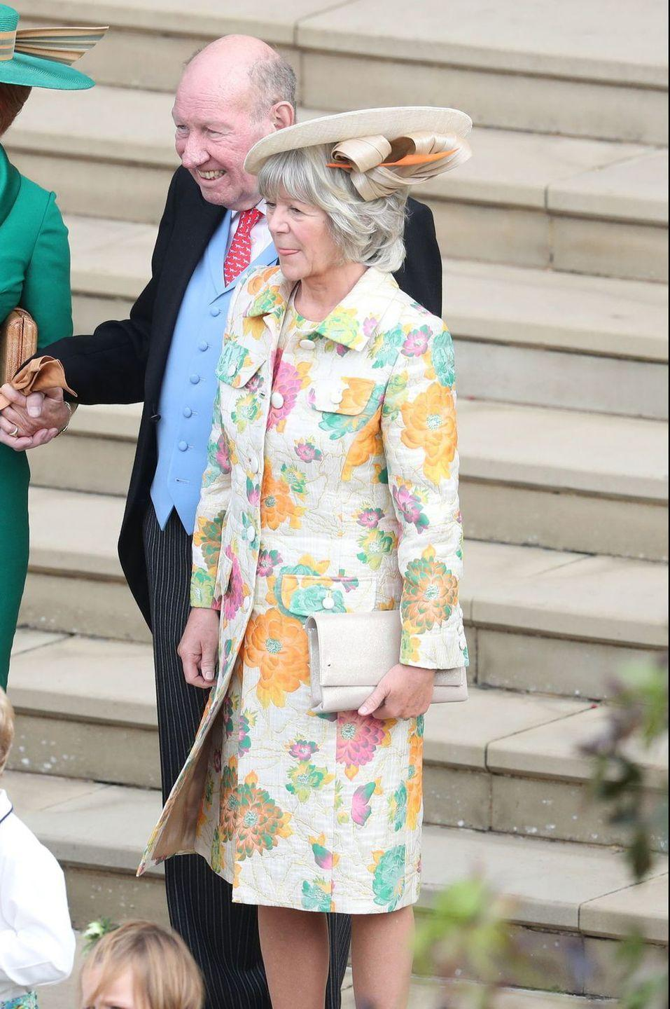 <p>Nicola Brooksbank, the mother of the groom, wore a simple yet festive hat to coordinate with her floral coat and dress.</p>