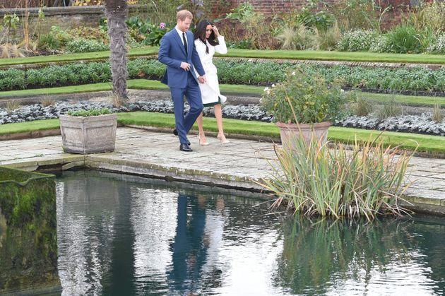 Harry and Meghan in the Sunken Garden for their engagement photocall in 2017. (Photo: Eddie Mulholland/Daily Telegraph/PA)