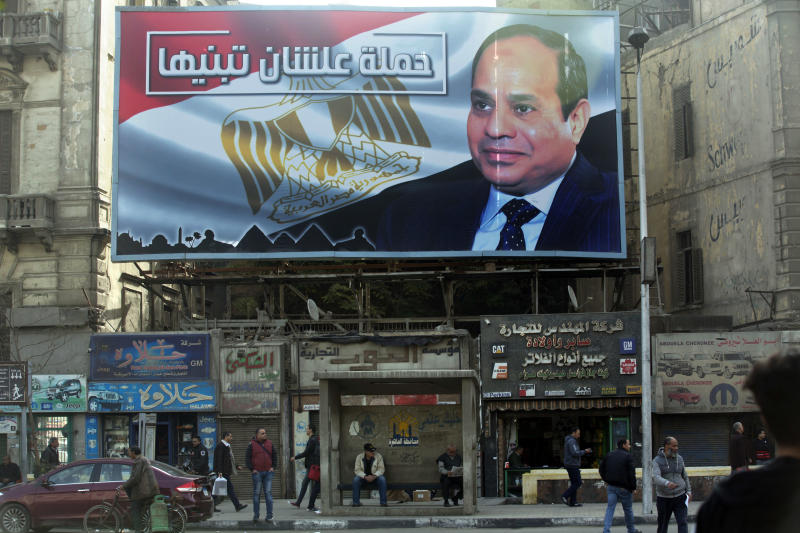 """A billboard supporting Egyptian President Abdel-Fattah el-Sissi in the presidential election scheduled for March hangs in downtown Cairo, Egypt, Monday, Jan. 22, 2018. El-Sissi is virtually guaranteed to win a second four-year term amid a heavy clampdown on dissent. Arabic reads, """"So you can build it."""" (AP Photo/Amr Nabil)"""