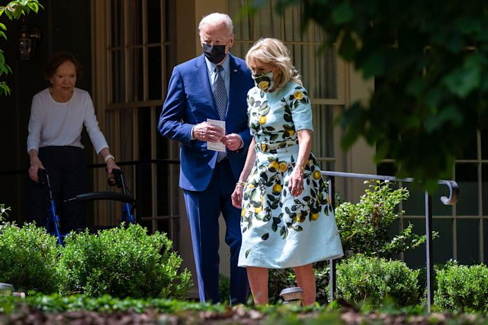 <p>Joe and Jill Biden leave the home of Jimmy and Rosalynn Carter in Plains, Georgia on 29 April.</p> (AP)