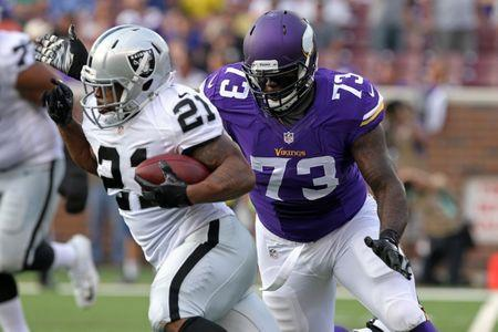 FILE PHOTO: Aug 8, 2014; Minneapolis, MN, USA; Minnesota Vikings defensive tackle Sharrif Floyd (73) tackles Oakland Raiders running back Maurice Jones-Drew (21) during the first quarter at TCF Bank Stadium. Mandatory Credit: Brace Hemmelgarn-USA TODAY Sports/File Photo
