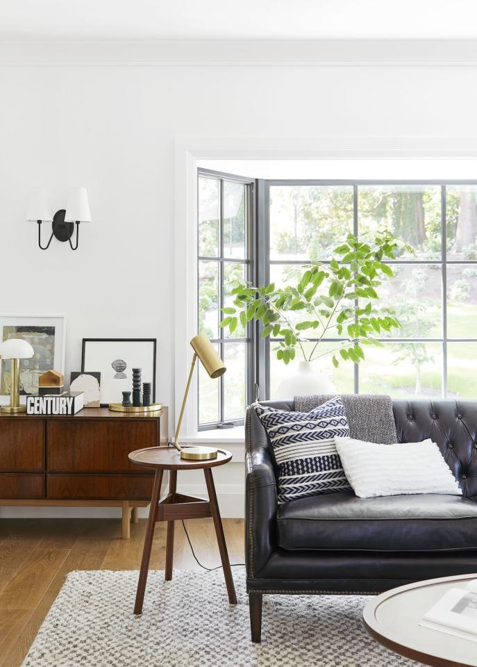 """<p>It's a common misconception that mixing pieces of different styles is a big no-no. However, designer <a href=""""https://stylebyemilyhenderson.com/"""" target=""""_blank"""">Emily Henderson</a> assures us that we can—there's just one trick to keep in mind. """"The truth is, you can mix almost any style as long as the pieces work well within your chosen color palette (I'd say three to four colors work best),"""" she explains.</p> <p>""""You should, of course, consider materials and silhouettes (everything should look like they are at least cousins, share some similar design DNA) but keeping your colors consistent is the safest bet for making your space look put together.""""</p> <p>—Emily Henderson, <a href=""""https://stylebyemilyhenderson.com/"""" target=""""_blank"""">Emily Henderson Design</a> </p>"""