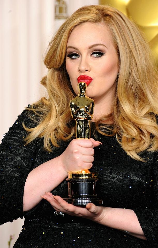 Adele poses in the press room during the Oscars at the Loews Hollywood Hotel on February 24, 2013 in Hollywood, California.