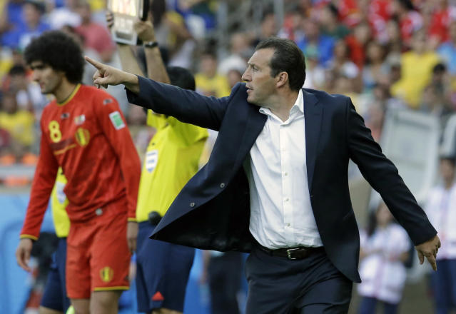 Belgium's head coach Marc Wilmots gestures as he prepares to introduce Belgium's Marouane Fellaini to the match during the group H World Cup soccer match between Belgium and Algeria at the Mineirao Stadium in Belo Horizonte, Brazil, Tuesday, June 17, 2014. (AP Photo/Hassan Ammar)