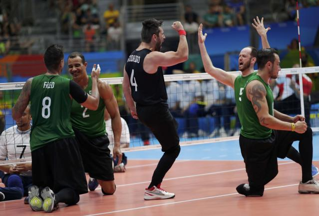 2016 Rio Paralympics - Sitting Volleyball - Men's Bronze Medal Match - Riocentro Pavilion 6 - Rio de Janeiro, Brazil - 18/09/2016. Players of team Brazil celebrate. REUTERS/Ueslei Marcelino FOR EDITORIAL USE ONLY. NOT FOR SALE FOR MARKETING OR ADVERTISING CAMPAIGNS.