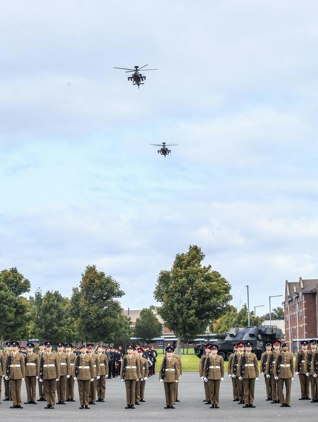 Two Apache helicopters perform a flypast during the parade
