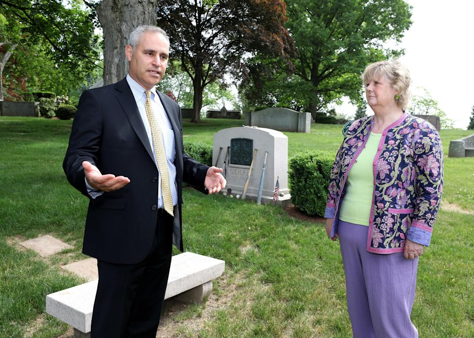 Matt Parisi, the president of Kensico Cemetery and Judith C. Mitchell, a public relations consultant, are pictured at Lou Gehrig's gravesite at Kensico Cemetery in Valhalla, May 25, 2021.