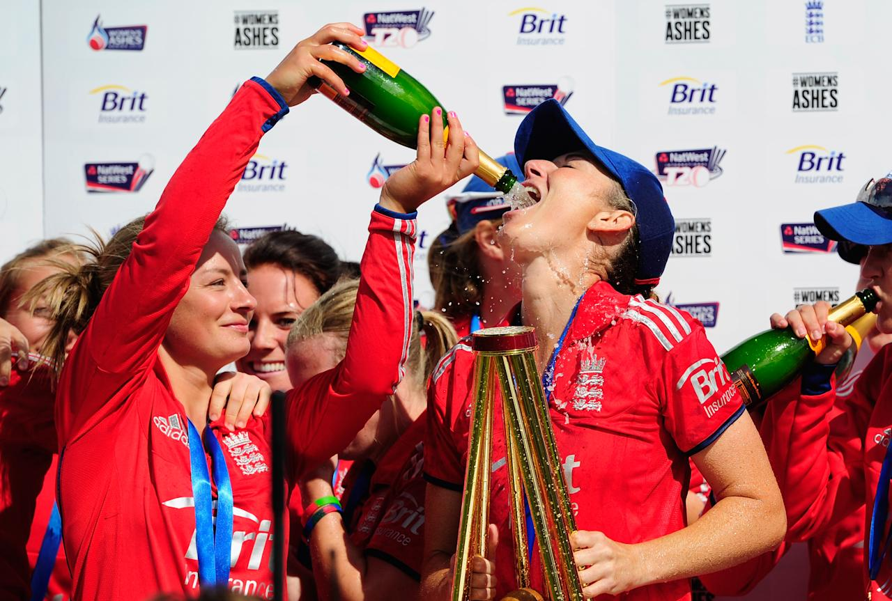 CHESTER-LE-STREET, ENGLAND - AUGUST 31:  England captain Charlotte Edwards is given champagne after the Women's Ashes Series - 3rd NatWest T20 between England Women and Australia Women at Emirates Durham ICG on August 31, 2013 in Chester-le-Street, England.  (Photo by Stu Forster/Getty Images)